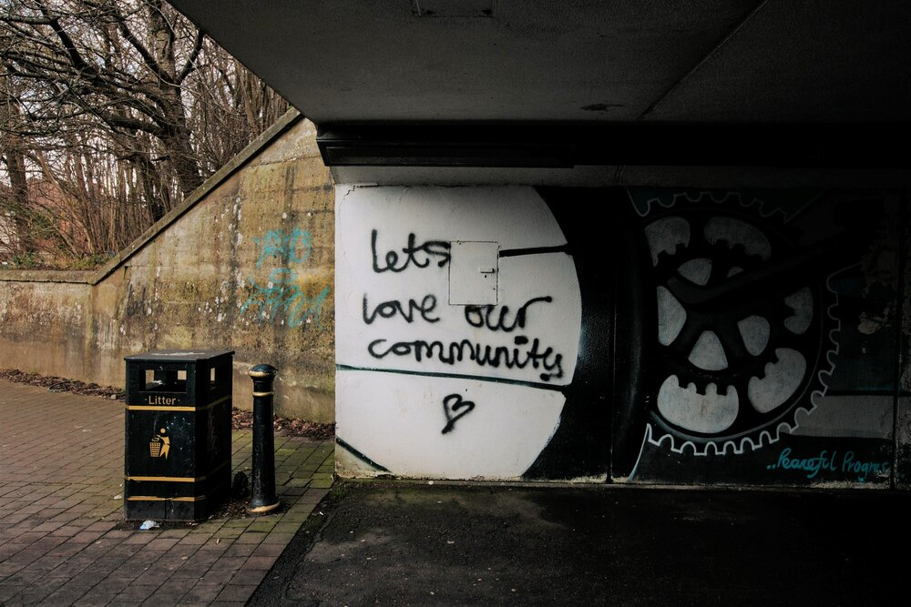 Picture of grafitti under bridge that reads 'let's love our community'